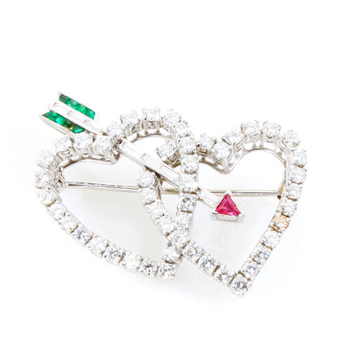 A diamond, ruby, emerald and platinum heart and arrow motif brooch