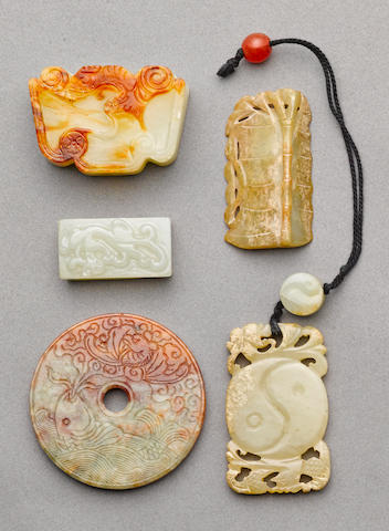 A group of six carved jade ornaments