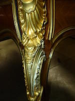 A Louis XV style gilt bronze mounted kingwood bureau plat <BR />late 19th century