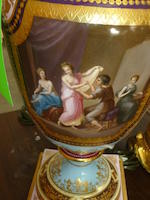A Royal Vienna style painted and gilt porcelain two-handled urn <BR />late 19th century