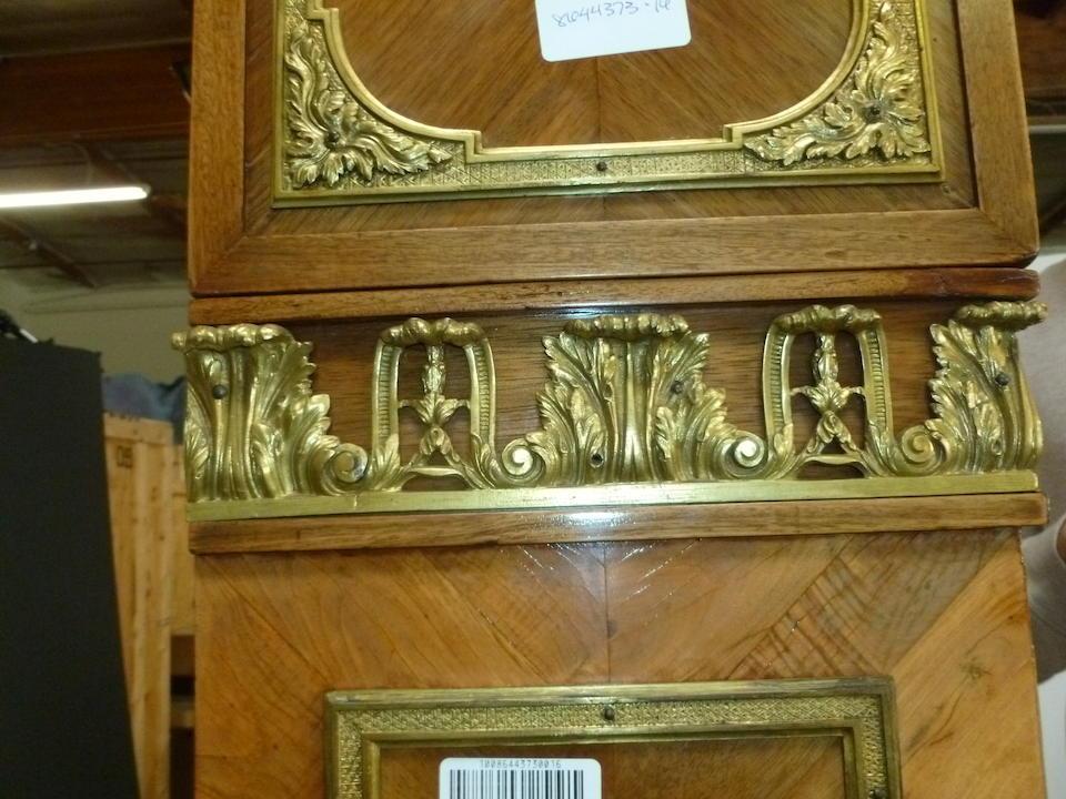 """A Louis XVI style gilt bronze mounted walnut régulateur """"au char d'Apollon""""  the gilt bronze after a model by Jacques Caffieri fourth quarter 19th century"""