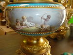 A pair of Sèvres style painted porcelain and gilt bronze mounted two-handled urns <BR />fourth quarter 19th century