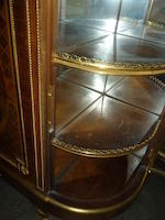 A Louis XVI style gilt bronze mounted kingwood and mahogany marquetry demi-lune side cabinet<BR />Edmond Poteau   late 19th century