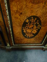 A Victorian gilt bronze mounted marquetry and parcel ebonized demi-lune side cabinet   fourth quarter 19th century
