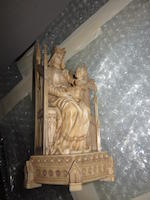 A Gothic style carved ivory Madonna and Child Enthroned, and a small ivory bust of Queen Victoria<BR />mid-19th century