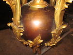 A Rococo style gilt and patinated bronze thirteen-light chandelier<BR />circa 1900