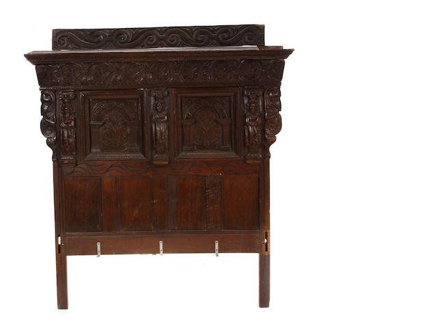 An Elizabethan style carved oak tester bed
