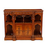 A Renaissance Revival carved walnut side cupboard