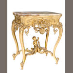 A Louis XV style carved giltwood and onyx center table
