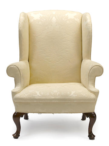 A George II upholstered wing chair
