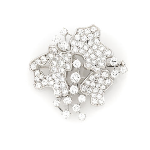 A diamond and white metal brooch