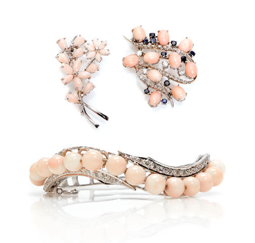 A group of coral, diamond, sapphire and white gold jewelry; comprising a bracelet and two brooches