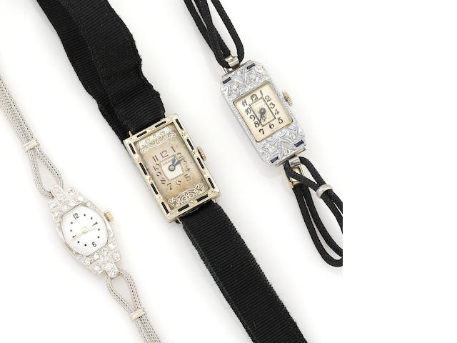 A collection of three diamond, enamel and 18k white gold cased watches