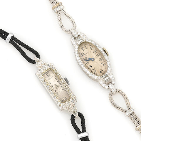 A collection of two diamond and platinum cased watches