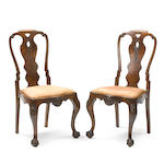 A set of twelve German Rococo style walnut dining chairs