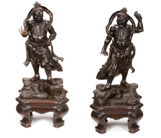 A pair of bronze temple gaurdian figures