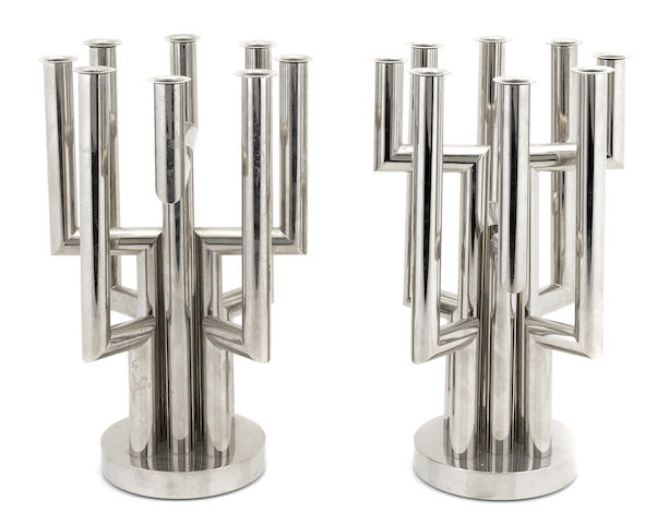 A pair of Hagenauer chrome plated brass eight light chandelbrum