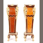A pair of Louis XV style gilt bronze mounted mixed wood pedestals