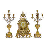 A French gilt metal clock garniture