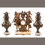 A Continental patinated metal and marble clock garniture
