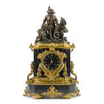 A French gilt and patinated bronze and slate mantel clock