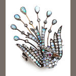 An opal, diamond and silver bird brooch