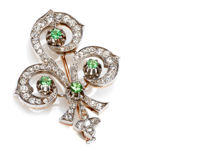A demantoid garnet and diamond fleur-de-lis brooch