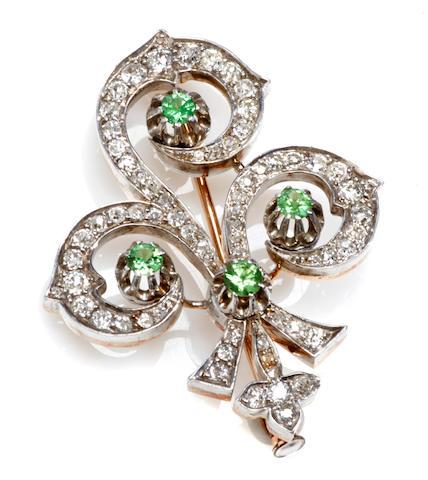 A demantoid garnet and diamond fleur-de-lis brooch
