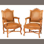 A pair of Louis XV style upholstered fauteuils