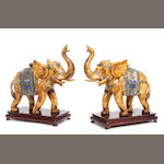 A pair of Chinese bone veneered models of elephants on stands