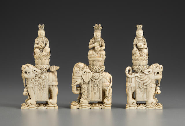 A set of three carved ivory Buddhist deities 19th century