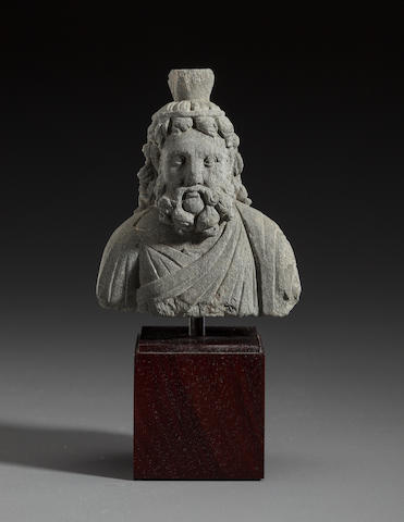 Stone bust of Serapis, Gandhara, 2nd century