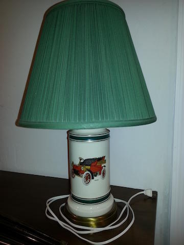 A porcelain table lamp with '1903 Ford,'