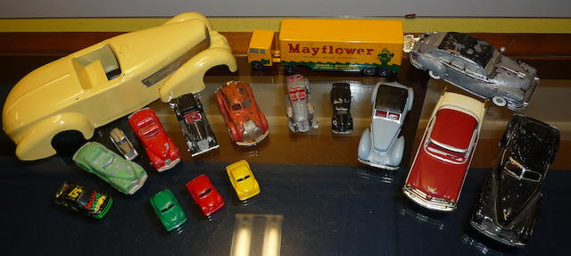 An accumulation of mid-century toy cars,