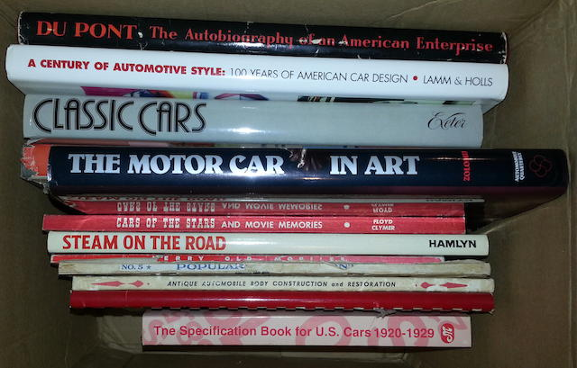 A box of hard and soft cover automotive books, various,