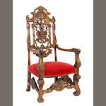 A Baroque style carved mixed wood armchair