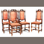A set of six Charles II style carved oak side chairs