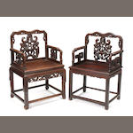 A pair of Chinese hardwood armchairs