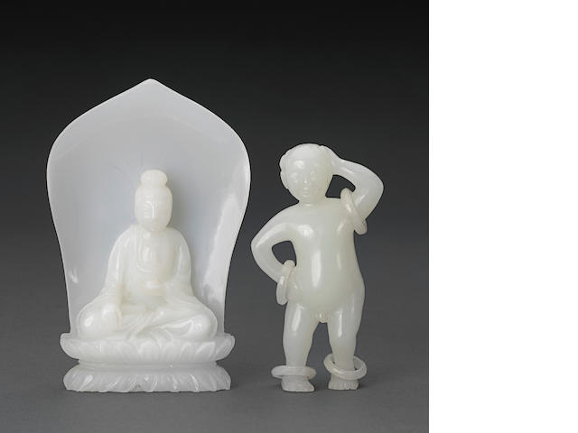 Two white glass statues