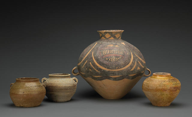 A group of four early ceramic jars