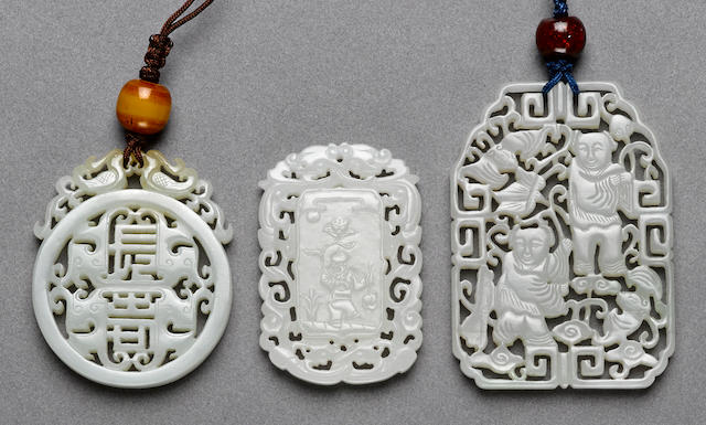 Three reticulated white jade plaques