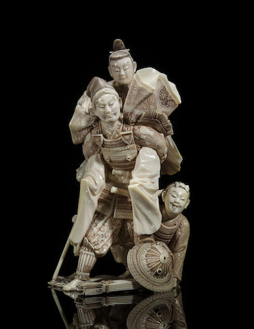 An ivory group of a Samurai in armor carrying a nobleman By Nobuharu, Meiji period (late 19th century)
