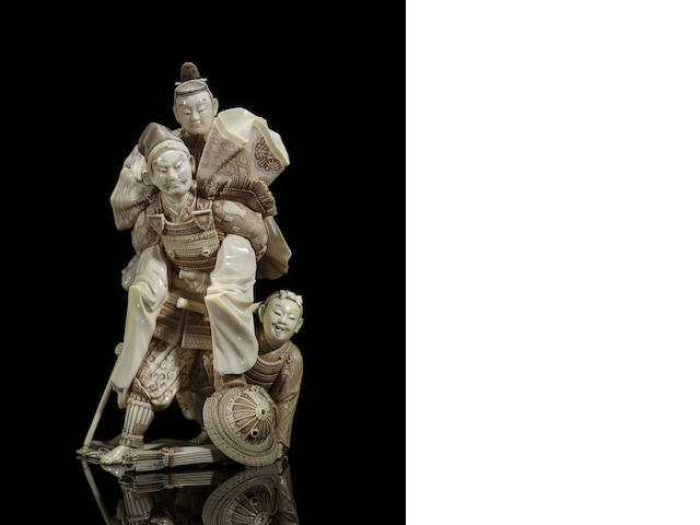 An ivory figure of a samurai in armor carrying a prince By Nobuharu, Meiji period (late 19th century)
