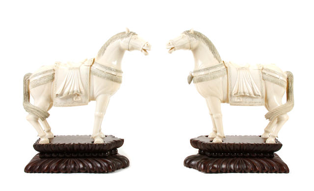 A pair of Chinese models of horses