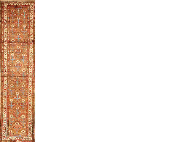 A Northwest Persian runner  Northwest Persia size approximately 3ft. 6in. x 14ft.