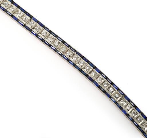 An art deco diamond and synthetic sapphire line bracelet, J.E. Caldwell & Co.,
