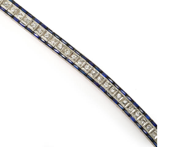 An art deco diamond and synthetic sapphire line bracelet, J.E. Caldwell & Co.,