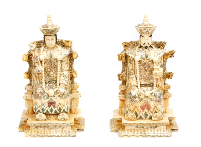 A pair of Chinese bone veneered figures of an Emperor and Empress