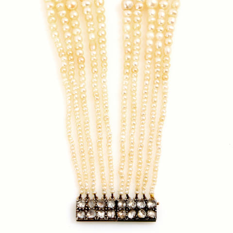 A cultured pearl, diamond and gold multi-strand bracelet