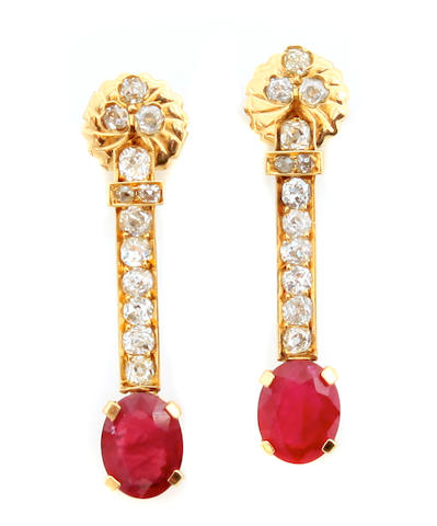 A pair of ruby, diamond and 14k gold earrings
